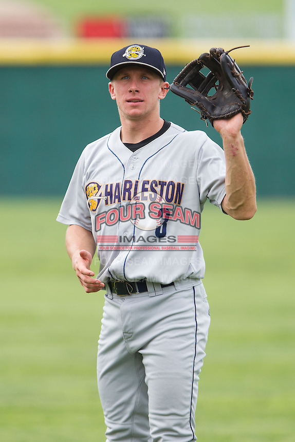 John Murphy (3) of the Charleston RiverDogs warms up in the outfield prior to the game against the Hickory Crawdads at L.P. Frans Stadium on May 25, 2014 in Hickory, North Carolina.  The RiverDogs defeated the Crawdads 17-10.  (Brian Westerholt/Four Seam Images)