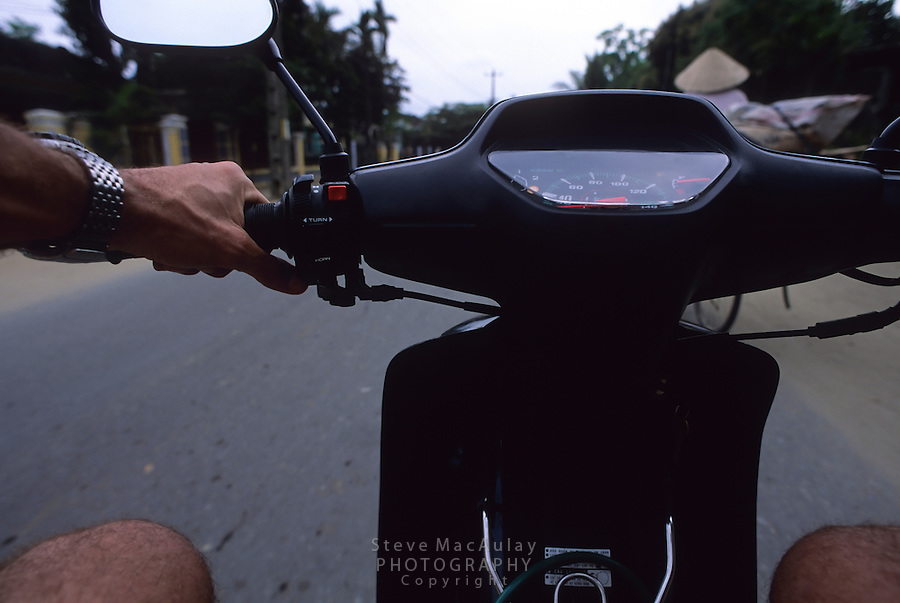 Point of View of tourist man riding scooter, Hoi An, ;Vietnam
