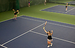 MIDDLEBURY, CT-122717JS08----Kelly Moore of Southbury, right, celebrates a point as she plays with other tennis enthusiasts during the Cardio & Point Play training program Thursday at the Middlebury Racquet Club in Middlebury.  Jim Shannon Republican-American