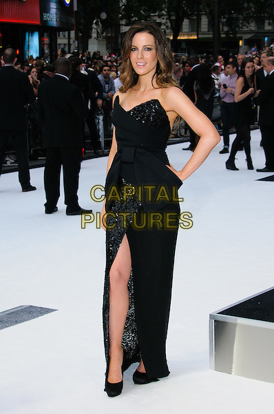 Kate Beckinsale.'Total Recall' UK Film Premiere arrivals, Vue Leicester Square, London, England..August 16th, 2012.full length black dress strapless sequins sequins bow-cinched waist slit split hand on hip     .CAP/CJ.©Chris Joseph/Capital Pictures.