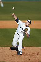 Wingate Bulldogs relief pitcher Sawyer Lee (14) in action against the Concord Mountain Lions at Ron Christopher Stadium on February 2, 2020 in Wingate, North Carolina. The Mountain Lions defeated the Bulldogs 12-11. (Brian Westerholt/Four Seam Images)