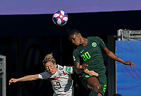 GRENOBLE, FRANCE - JUNE 22: Svenja Huth #9 of the German National Team, Chidinma Okeke #20 of the Nigerian National Team battle for head ball during a game between Panama and Guyana at Stade des Alpes on June 22, 2019 in Grenoble, France.