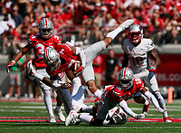 A pass intended for UNLV Rebels wide receiver Devonte Boyd (83) was tipped by Ohio State Buckeyes cornerback Denzel Ward (12) and caught by Ohio State Buckeyes safety Damon Webb (7) for an interception during the second quarter of Saturday's NCAA Division I football game at Ohio Stadium in Columbus on September 23, 2017. Ohio State led 44-7 at the half. [Barbara J. Perenic/Dispatch]