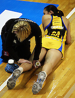 Pulse goal attack Paula Griffin gets a calf massage after an injury during the ANZ Netball Championship match between the Central Pulse and Northern Mystics, TSB Bank Arena, Wellington, New Zealand on Monday, 4 May 2009. Photo: Dave Lintott / lintottphoto.co.nz