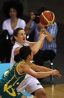 Tall Ferns guard Kate McMeeken-Ruscoe takes a pass under pressure from Alicia Poto during the International women's basketball match between NZ Tall Ferns and Australian Opals at Te Rauparaha Stadium, Porirua, Wellington, New Zealand on Monday 31 August 2009. Photo: Dave Lintott / lintottphoto.co.nz
