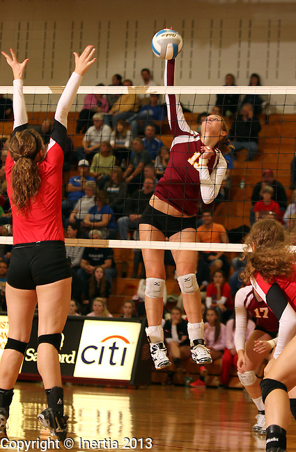 SIOUX FALLS, SD - OCTOBER 25:  Tagyn Larson #13 from Roosevelt tries to get a kill past Audrey Bunge #17 from Rapid City Central in the first game of their match Friday night at Roosevelt. (Photo by Dave Eggen/Inertia)