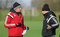 SWANSEA, WALES - JANUARY 28: (L-R) Diego Bortoluzzi and  head coach Francesco Guidolin observe the players training during the Swansea City Training Session on January 28, 2016 in Swansea, Wales.