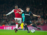Arsenal's Danny Welbeck  and West Ham's Aaron Cresswell during the Carabao Cup QF match between Arsenal and West Ham United at the Emirates Stadium, London, England on 19 December 2017. Photo by Andrew Aleksiejczuk / PRiME Media Images.