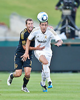 LOS ANGELES, CA – July 16, 2011: Gregg Berhalter (3) of LA Galaxy and Joselu of Real Madrid (29) during the match between LA Galaxy and Real Madrid at the Los Angeles Memorial Coliseum in Los Angeles, California.