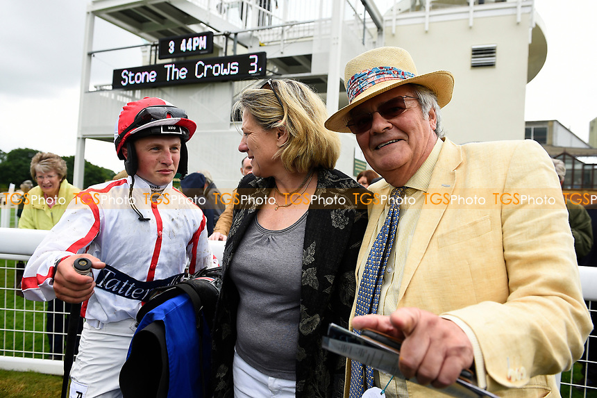 Jockey Tom Marquand, trainer Eve Johnson Houghton and owner in the winners enclosure after winning The Whitsbury Manor Stud Bibury Cup Handicap, during Whitsbury Manor Stud Bibury Cup Day Racing at Salisbury Racecourse on 28th June 2017
