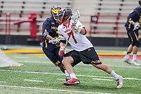 College Park, MD - April 1, 2017: Maryland Terrapins Tim Rotanz (7) runs pass a Michigan Wolverines defender during game between Michigan and Maryland at  Capital One Field at Maryland Stadium in College Park, MD.  (Photo by Elliott Brown/Media Images International)