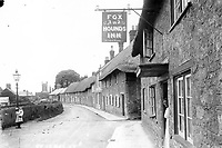BNPS.co.uk (01202 558833)<br /> Pic: ShaftesburyHistoricalSociety/BNPS<br /> <br /> Pictured: The Fox and Hounds pub in St James's Street, Shaftesbury, not a car in sight.<br /> <br /> These charming photos reveal everyday life at the turn of the 20th century in a thriving market town later made famous by a TV advert.<br /> <br /> The black and white snapshots of Shaftesbury, Dorset, were taken by Albert Tyler who set up a photography business there in 1901.<br /> <br /> There are various street scenes and also images of the locals in traditional attire, with men in flatcaps and women in bonnets.<br /> <br /> Tyler photographed the busy opening of the town market in 1902, and a garden party where men played croquet.