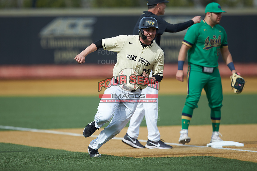 Michael Ludowig (22) of the Wake Forest Demon Deacons hustles towards home plate during the game against the Notre Dame Fighting Irish at David F. Couch Ballpark on March 10, 2019 in  Winston-Salem, North Carolina. The Demon Deacons defeated the Fighting Irish 7-4 in game one of a double-header.  (Brian Westerholt/Four Seam Images)