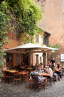 Aperitivo hour in the Trastevere district of Rome, Italy