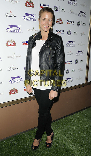 Gemma Atkinson<br /> attended the Slazenger Wimbledon Party, Whisky Mist bar &amp; nightclub, Hertford St., London, England, UK, 27th June 2013.<br /> full length black leather jacket jeans  white top trousers peep toe shoes studded <br /> CAP/CAN<br /> &copy;Can Nguyen/Capital Pictures