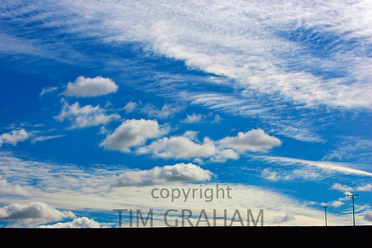 Cirrus clouds and power cable poles, Nottinghamshire, United Kingdom