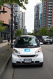 CANADA, Vancouver, British Columbia, car2go car is parked on a street in downtown Vancouver, part of a car sharing program