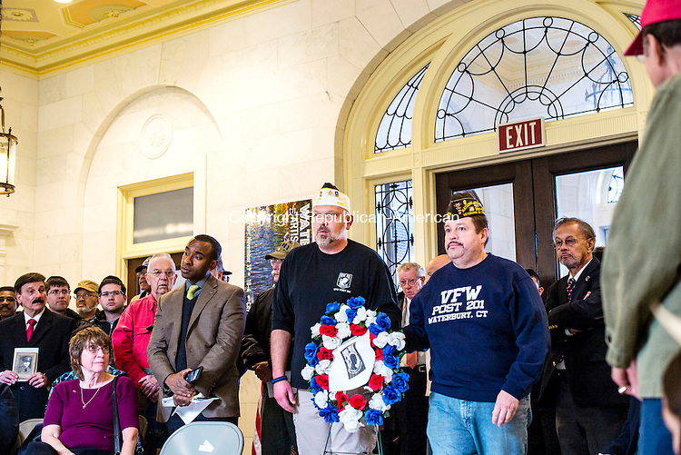 Waterbury, CT- 11 November 2016-111116CM04-  From left, Karl Steiner, an Iraq War Veteran, who served with the U.S. Army and Gerry Diaz who also served with the U.S. Army present a POW/MIA wreath during a Veterans Day ceremony at Waterbury City Hall on Friday.     Christopher Massa Republican-American
