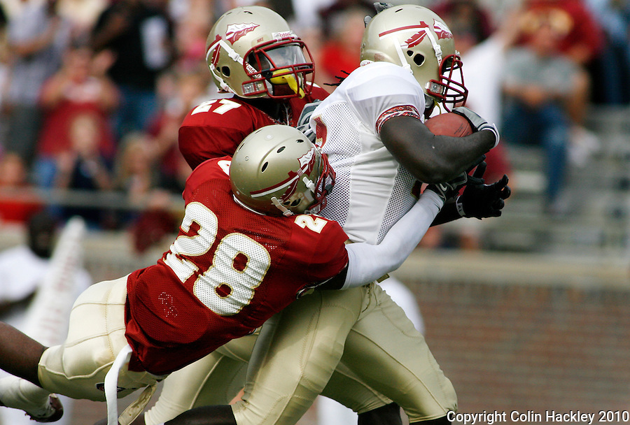 TALLAHASSEE, FL 4/10/10-FSU-SPRING FB10 CH-It took Garnet's Xavier Rhodes, left, and Dionte Allen to bring Gold's Debrale Smiley to the ground at the close of his 48 yard run during first half Spring Game action Saturday at Doak Campbell Stadium in Tallahassee. .COLIN HACKLEY PHOTO