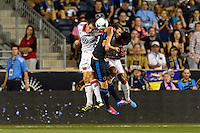 Conor Shanosky (17) and James Riley (2) of D. C. United goes up for a header with Jack McInerney (9) of the Philadelphia Union. The Philadelphia Union defeated D. C. United 2-0 during a Major League Soccer (MLS) match at PPL Park in Chester, PA, on August 10, 2013.