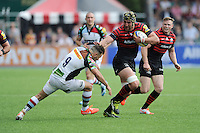 Kelly Brown of Saracens hands off Danny Care of Harlequins during the Aviva Premiership semi final match between Saracens and Harlequins at Allianz Park on Saturday 17th May 2014 (Photo by Rob Munro)