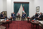 Palestinian President Mahmoud Abbas, meets with Qatar's Ambassador to the Palestinian Authority, Mohammed Al Emadi, in the West Bank city of Ramallah, on February 24, 2020. Photo by Thaer Ganaim