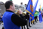 Cornet-player Stephen Murray of Drogheda Brass Band plays the Last Post and Reveille. Picture: www.newsfile.ie