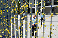 Hong Kong, Government Offices, 28 September 2014<br /> <br /> Middle of the day at the entrance of the HK government offices. Protesters are prepared against pepper spray and teargas with plastic coats and goggles. Already then the police tries to block the entry and exit points of the area. <br /> Yellow ribbons are the symbol of the Occupy Central movement.<br /> <br /> Photo Kees Metselaar