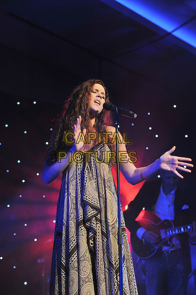 Joss Stone.'Global Angels Awards', The Park Plaza Hotel, Westminster, London, England. 2nd December 2011..music on stage live concert gig performing half length microphone   brown print scarf paisley dress singing  hands .CAP/MAR.© Martin Harris/Capital Pictures.