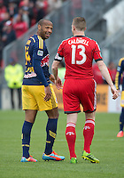 Toronto, Ontario - May 17, 2014: New York Red Bulls forward Thierry Henry #14 has a word with Toronto FC defender Steven Caldwell #13 during a game between the New York Red Bulls and Toronto FC at BMO Field. Toronto FC won 2-0.