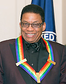 Pianist, keyboardist, bandleader and composer Herbie Hancock waits to pose for a group photo with the other four recipients of the 2013 Kennedy Center Honors following a dinner hosted by United States Secretary of State John F. Kerry at the U.S. Department of State in Washington, D.C. on Saturday, December 1, 2013.  The 2013 honorees are opera singer Martina Arroyo; pianist, keyboardist, bandleader and composer Herbie Hancock; pianist, singer and songwriter Billy Joel; actress Shirley MacLaine; and musician and songwriter Carlos Santana.<br /> Credit: Ron Sachs / CNP