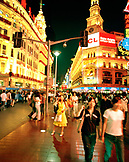 CHINA, Shanghai, crowd of people walking on urban shopping street