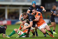 Sam Underhill of Bath Rugby is tackled to ground. European Rugby Champions Cup match, between Bath Rugby and Benetton Rugby on October 14, 2017 at the Recreation Ground in Bath, England. Photo by: Patrick Khachfe / Onside Images