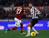 Calcio, quarti di finale di Coppa Italia: Roma vs Juventus. Roma, stadio Olimpico, 21 gennaio 2014.<br /> Juventus midfielder Andrea Pirlo, right, in action past AS Roma forward Gervinho, of Ivory Coast, during the Italian Cup round of eight final football match between AS Roma and Juventus, at Rome's Olympic stadium, 21 January 2014.<br /> UPDATE IMAGES PRESS/Isabella Bonotto
