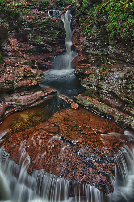 This red rock arrowhead formation makes Adams Falls one of the most unique in the world, sitting near the base of Ricketts Glen park
