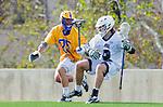 Los Angeles, CA 02-26-17 - Ryan Phan (UCSB #25) and Jon Edwards (Loyola Marymount #2) in action during the MCLA conference game between LMU and UC Santa Barbara.  Santa Barbara defeated LMU 15-0.