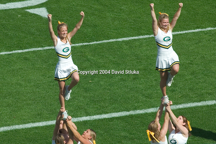 The Green Bay Packers cheerleaders show their spirit before the Chicago Bears NFL football game at Lambeau Field on September 19, 2004 in Green Bay, Wisconsin. The Bears beat the Packers 21-10. (Photo by David Stluka)