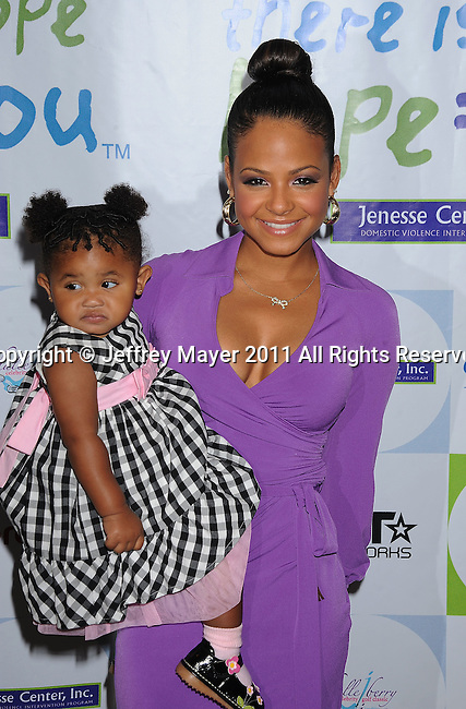 BEVERLY HILLS, CA - APRIL 17: Christina Milian and daughter arrive at the Silver Rose Gala And Auction at Beverly Hills Hotel on April 17, 2011 in Beverly Hills, California.