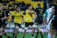 Vaea Fifita and Brodie Retallick get to know each other better during the Super Rugby quarterfinal match between the Hurricanes and Chiefs at Westpac Stadium in Wellington, New Zealand on Friday, 20 July 2018. Photo: Dave Lintott / lintottphoto.co.nz