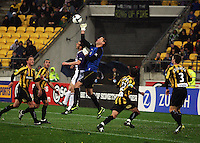 Phoenix keeper Mark Paston punches away a high ball during the A-League football match between Wellington Phoenix and Perth Glory at Westpac Stadium, Wellington, New Zealand on Sunday, 16 August 2009. Photo: Dave Lintott / lintottphoto.co.nz