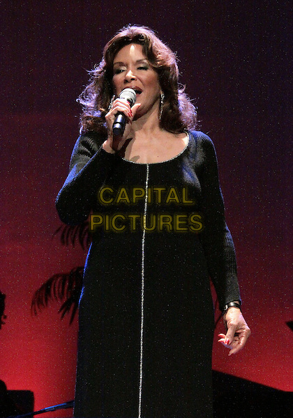 FREDA PAYNE .Haiti Food Project Second Aid Benefit Gala  held at  The American Jewish University, Beverly Hills, CA, USA, .4th Febuary 2010..half length black microphone singing live on stage music concert gig dress .CAP/ADM/TC.©T.Conrad/Admedia/Capital Pictures