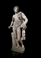Roman statue of Apollo .Marble. Perge. 2nd century AD. Antalya Archaeology Museum; Turkey. Against a black background.