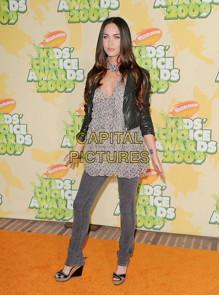 MEGAN FOX .at The 2009 Nickelodeon's Kids Choice Awards held at Pauley Pavilion in West Hollywood, California, USA, .March 28th 2009.                                                                     .full length black leather jacket jeans white cream print top scarf wedges gray grey cropped ruffle tiered ruffles .CAP/DVS.©Debbie VanStory/RockinExposures/Capital Pictures