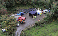 Pictured: Aerial view showing a fire engine and police on stand by near Gleision Colliery. Friday 16 September 2011<br /> Re: It has been announced that the dead body of one of the miners has been found by emergency services trying to rescue four colliers that have been trapped at Tareni Gleision drift colliery at Cilybebyll, near Pontardawe, south Wales.<br /> The four men who are subject of the rescue operation have been named as Phillip Hill, aged 45, from Neath, Charles Bresnan, aged 62, from the Swansea Valley, David Powell, aged 50, from the Swansea Valley, and Garry Jenkins, aged 39, from the Swansea Valley.