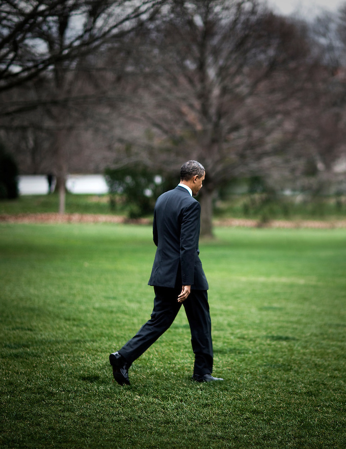 U.S. President Barack Obama walks through the Colonnade at the White House in Washington.  ...