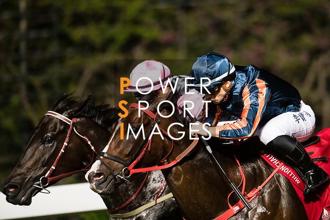 Jockey #8 Umberto Rispoli (R) riding Bank On Red during the race 6 of Hong Kong Racing at Happy Valley Race Course on November 08, 2017 in Hong Kong, China. Photo by Marcio Rodrigo Machado / Power Sport Images