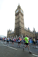17 APR 2011 - LONDON, GBR - Runners pass the Houses of Parliament and Big Ben during the London Marathon .(PHOTO (C) NIGEL FARROW)