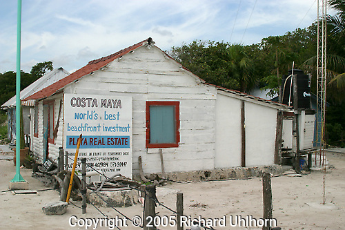 Real estate sign in Costa Maya, Mexico on the Caribbean coast south of Cozumel and Cancun...Carribean, old building, real estate, signs