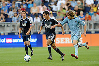 Vancouver Whitecaps midfielder Shea Salinas (22( pursued by Sporting KC defender Chance Myers... Sporting KC defeated Vancouver Whitecaps 2-1 at LIVESTRONG Sporting Park, Kansas City, Kanas.