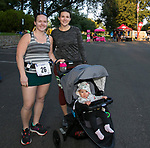 Jessica Baldridge, left, Nicole Whipple and her 8 month old daughter Lily during the 51st Annual Journal Jog in  Reno on Sunday, Sept. 8, 2019.
